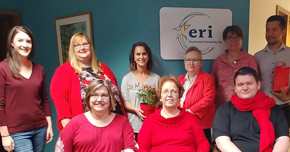 ERI employees dressed in red clothes suporting national disability employment awareness month